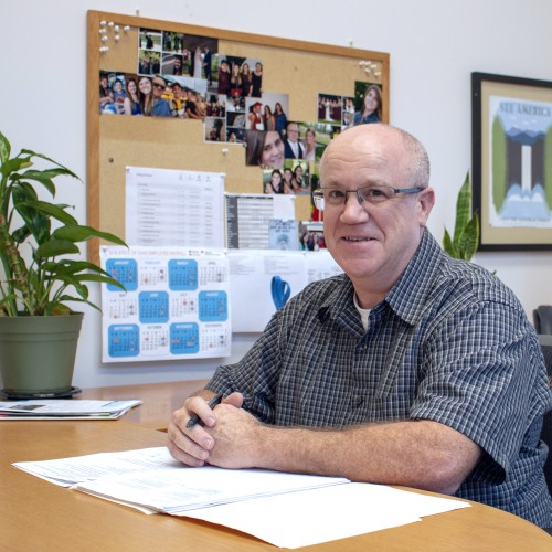 Photo of Eric Maynard in his office at the State Library