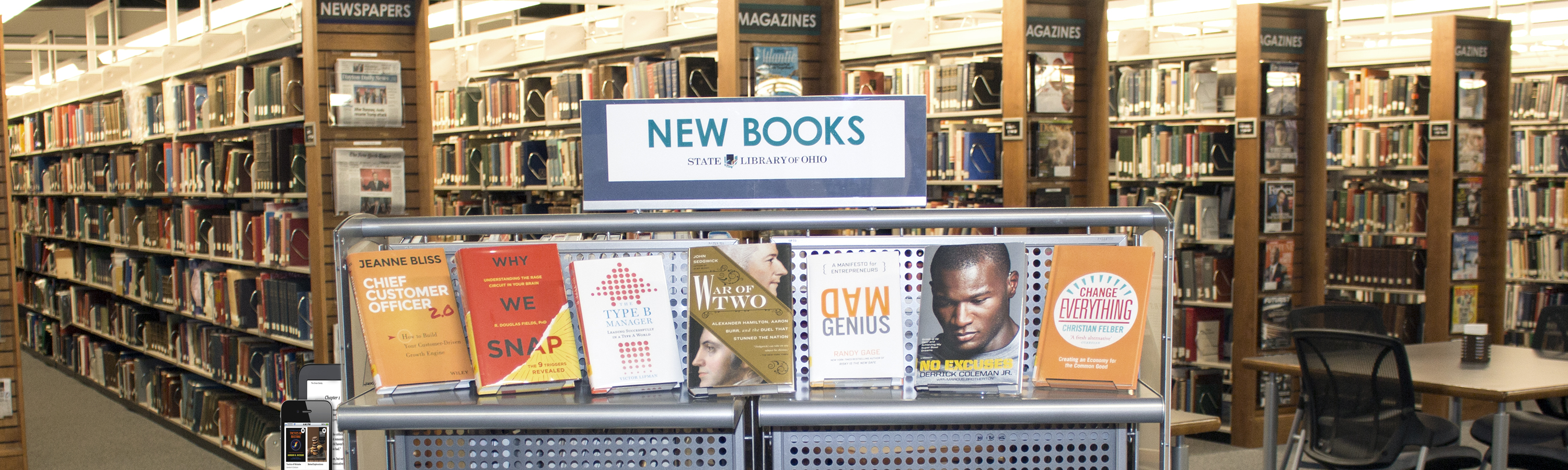 Photo of New Books display with mobile devices at the State Library of Ohio